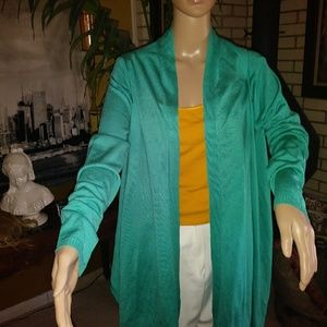 Teal color shawl/shrug.